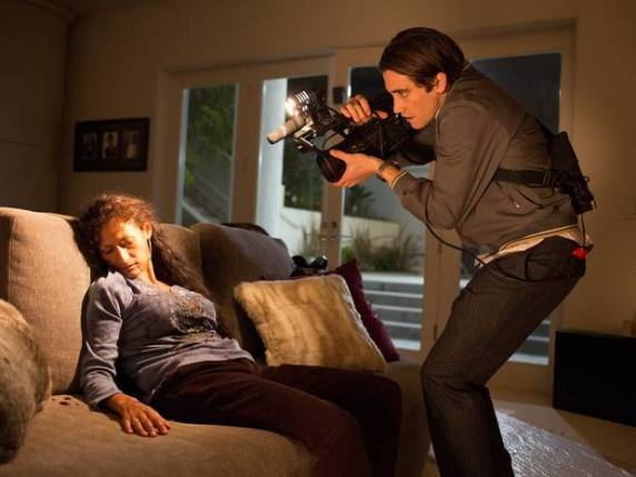 Say 'cheese!' - Jake Gyllenhaal as demented videographer Lou Bloom in the grisly thriller 'Nightcrawler'.